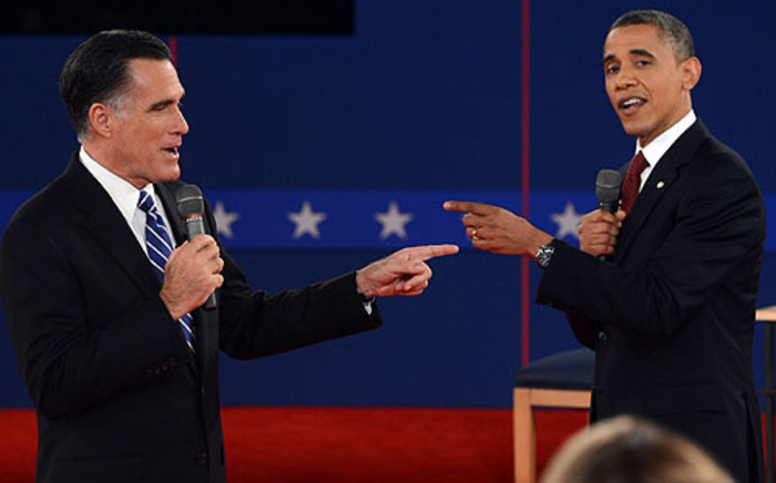 Barack Obama and Mitt Romney battle during the 2nd presidential debate in New York. Picture: AFP/Saul Loeb