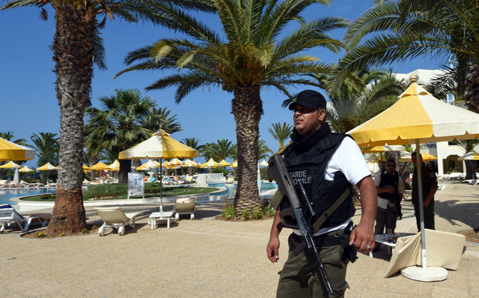 FILE: A Tunisian security member stands next to a swimming pool at the resort town of Sousse following a shooting attack. Picture: AFP.