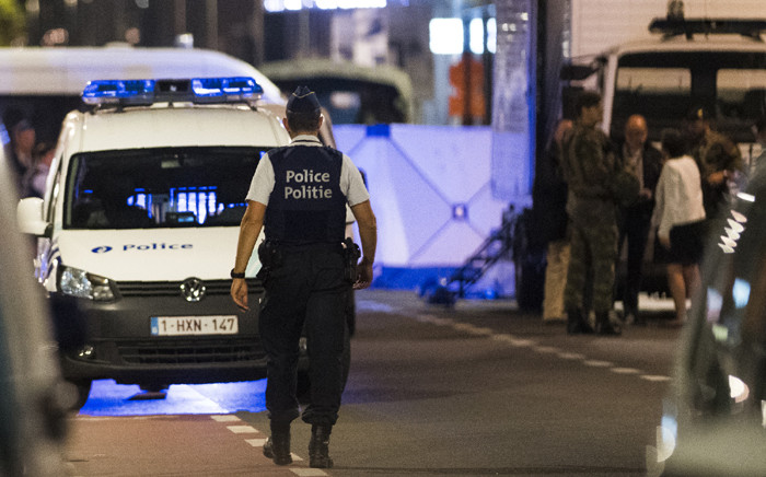 Policemen stand guard the Boulevard Emile Jacqmain - Emile Jacqmainlaan in the city centre of Brussels on August 25, 2017, where a man is alleged to have attacked soldiers with a knife and was shot. Picture: AFP.