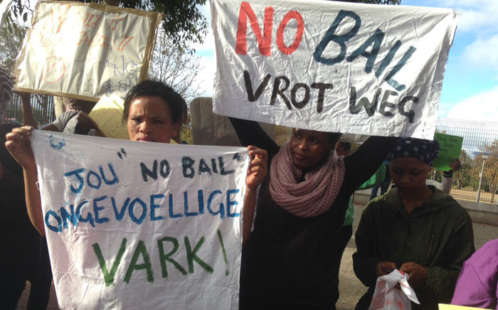 Community members brandishing posters outside court in support of Rene Roman's family. Picture: Lauren Isaacs/EWN