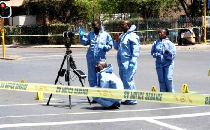 FILE: Crime scene investigators at the scene in Bedfordview where Sam Issa was shot and killed on 12 October 2013. Picture: @EdenvaleJourno/Twitter.