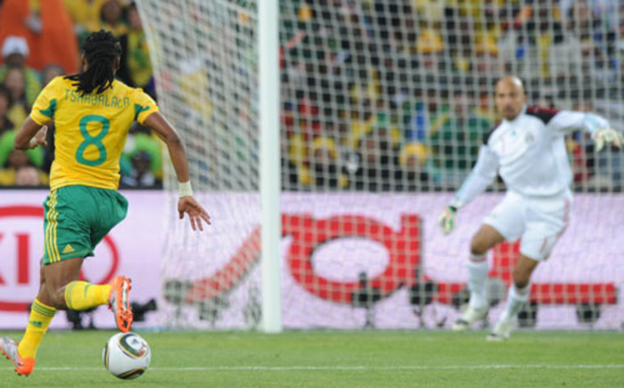 FILE: South Africa's midfielder Siphiwe Tshabalala (L) runs with the ball to score the opening goal during their Group A first round 2010 World Cup football match on June 11, 2010 at Soccer City stadium in Soweto. Picture: AFP PHOTO / PEDRO UGARTE