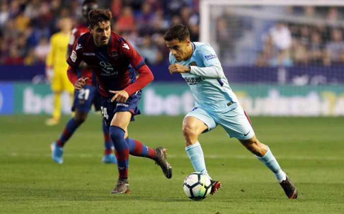 Barcelona's (right) Philippe Coutinho runs at the Levante defence during their La Liga match on 13 May 2018. Picture: @FCBarcelona/Twitter