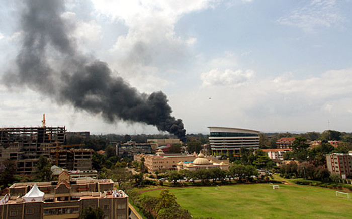 Smoke rises from the beseiged Westgate shopping mall in Nairobi following a loud explosion. Kenyan security forces were locked in a fierce, final battle with Somali Islamist gunmen. Picture: AFP