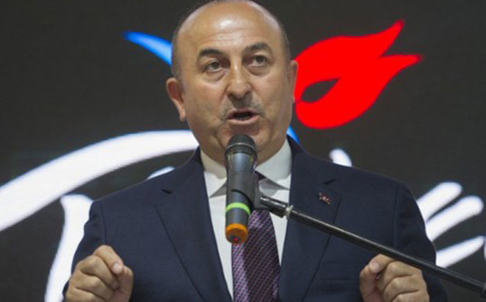 FILE: Turkish Foreign Minister Mevlut Cavusoglu delivers a speech during his visit to his country's hall at the Internationale Tourismus-Boerse (ITB) international travel trade show in Berlin on 8 March 2017. Picture: AFP.