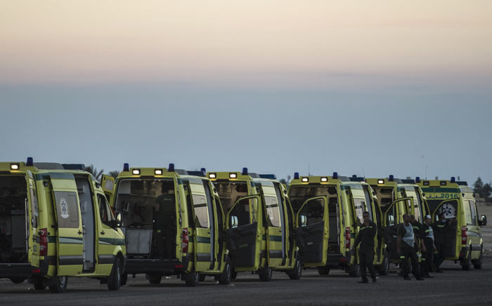 Egyptian ambulances line up at Kabret military air base by the Suez Canal on 31 October 2015, after victims of a Russian airliner that crashed in the Sinai Peninsula were brought to the base before being transported to a morgue. Picture: AFP