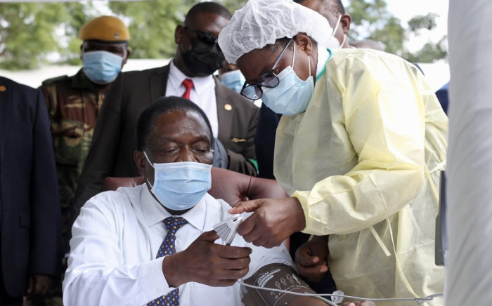 Zimbabwe's President Emmerson Mnangagwa prepares to receive his second dose of the COVID-19 vaccine in April 2021. Picture: Twitter/@edmnangagwa