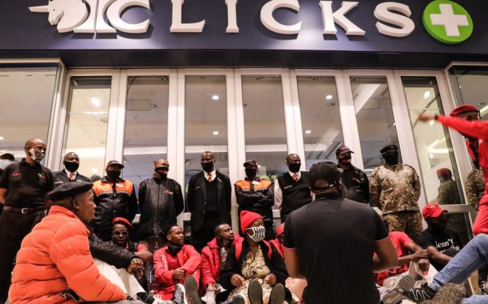 EFF members protest outside a Clicks store at the Sandton City shopping centre in Johannesburg on 7 September 2020. Picture: Kayleen Morgan/EWN