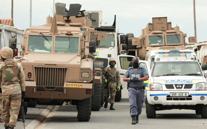 SAPS members and SANDF soldiers deploy in the Mitchells Plain area in Cape Town to enforce the Disaster Management Act and to ensure the adherence of the lockdown regulations on 20 April 2020. Picture: @SAPoliceService/Twitter
