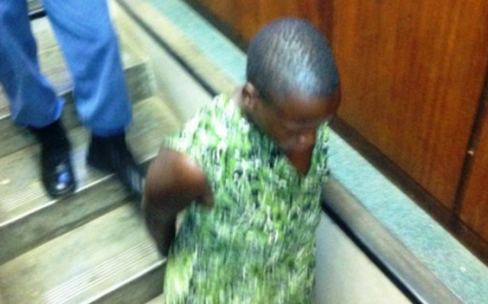 Esther Moyana is pictured as she entered the Heidelberg Magistrate's Court on 18 October 2013 to face two charges of murder. She is accused of poisoning her two young daughters. Picture: Mia Lindeque/EWN
