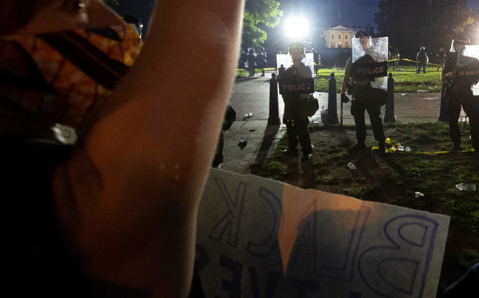Protesters clash with police outside White House on Saturday, 30 May 2020. Picture: AFP