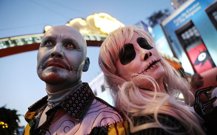 Cosplayers pose on the street outside San Diego Comic-Con on 19 July, 2018 in San Diego, California. Picture: AFP