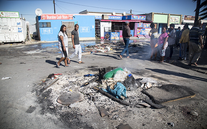 Debris litters Dumani Road in Dunoon after a night of protests and looting. Picture: Thomas Holder/EWN