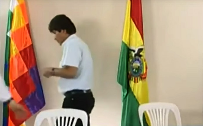 Grab taken from a handout video released by Bolivia TV showing Bolivian President Evo Morales leaving after announcing his resignation on 10 November 2019 in a televised address from Cochabamba, Bolivia, caving in following three weeks of sometimes-violent protests over his disputed re-election after the army and police withdrew their backing. Picture: AFP