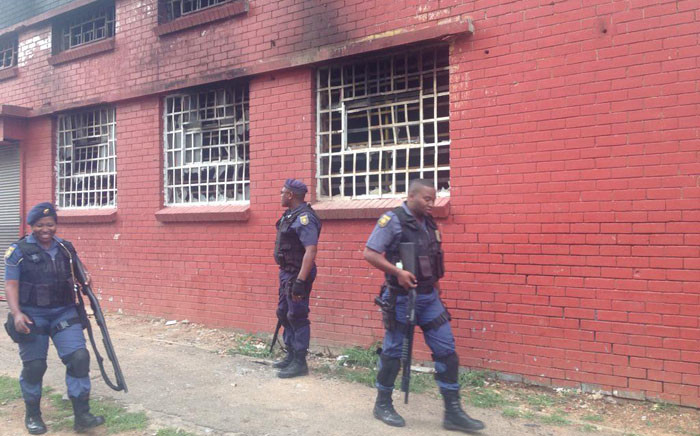 FILE: Police maintain a strong presence in the volatile Jeppestown area on 17 April 2015. Picture: Mia Lindeque/EWN