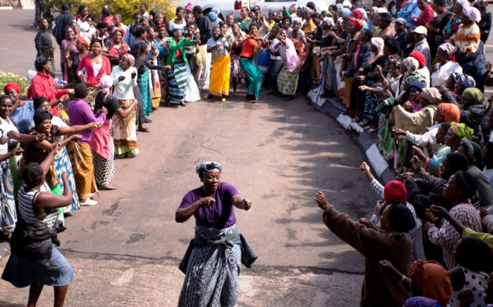 Malawi's United Democratic Front (UDF) party supporters sing and dance on 24 May, 2014 to support their party's president. Picture: AFP.