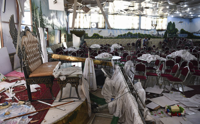 Afghan men investigate in a wedding hall after a deadly bomb blast in Kabul on 18 August 2019.  Picture: AFP