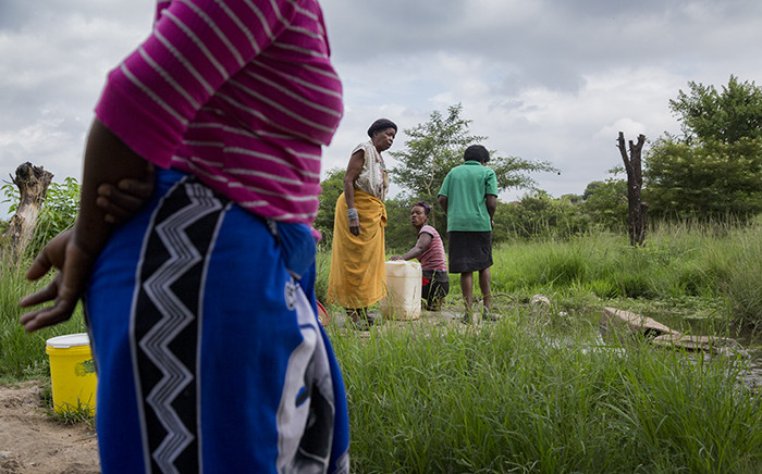 Dididi community members collect water at a stream. Picture: Sthembiso Zulu/EWN