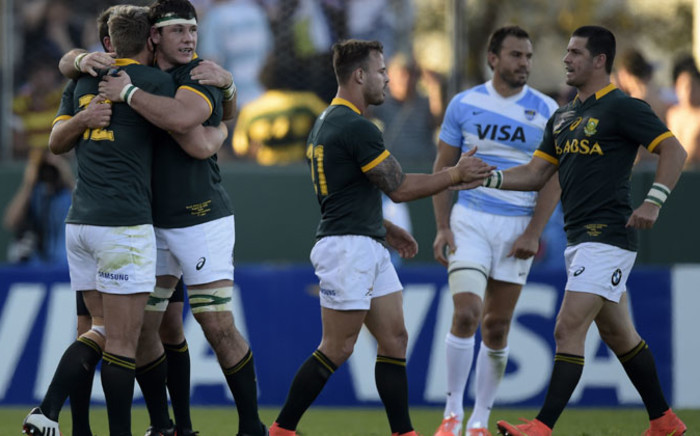 The Springboks celebrate after defeating Argentina's Los Pumas by 33 to 31 in the Rugby Championship second round match at Padre Ernesto Martearena stadium in Salta on 23 August 2014. Picture: AFP/ Juan Mabromata