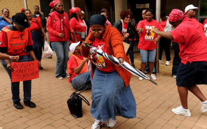FILE: Workers affiliated to the Communication Workers Union (CWU) strike in Johannesburg on 29 October 2012. Picture: Werner Beukes/SAPA
