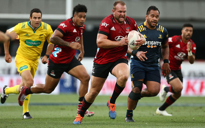 The Crusaders' Brodie McAlister runs the ball into Highlanders territory during their Super Rugby Aotearoa match in Dunedin on 26 February 2021. Picture: AFP