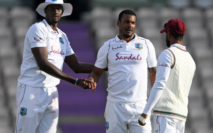 FILE: West Indies' Shannon Gabriel (C) celebrates with West Indies' Jason Holder (L) after bowling England's Dom Bess (not pictured) on the fourth day of the first Test cricket match between England and the West Indies at the Ageas Bowl in Southampton, southwest England on 11 July 2020. Picture: AFP