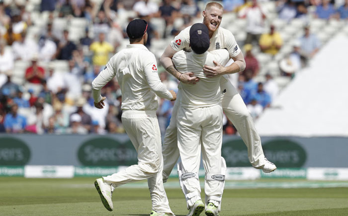 England's Ben Stokes (R) celebrates with teammates after taking the final Indian wicket on day four of the first Test cricket match between England and India at Edgbaston in Birmingham on August 4, 2018. England beat India by 31 runs. Picture: AFP