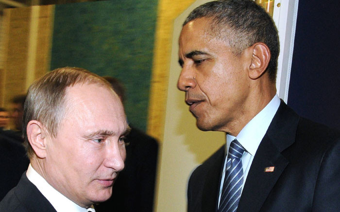 Russian President Vladimir Putin (left) meets with US President Barack Obama on the sidelines of the UN conference on climate change on 30 November 30 2015 at Le Bourget, on the outskirts of Paris. Picture: AFP.