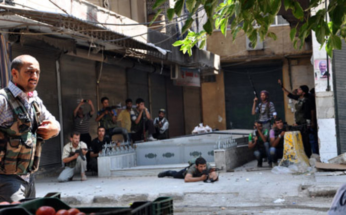 Free Syrian Army opposition fighters battle government security forces during the siege of the Shaar district police station in the northern Syrian city of Aleppo. Picture: AFP