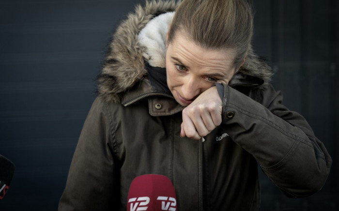 Denmark's Prime Minister Mette Frederiksen reacts as she meets journalists after visiting a closed and empty mink farm near Kolding, Denmark, on November 26, 2020. Picture: AFP.