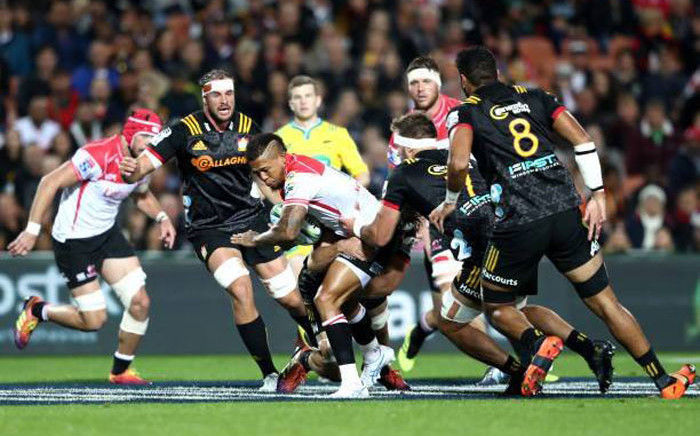 The Lions's Elton Jantjies is tackled by his Chiefs opponents during their Super Rugby match on 19 April 2019. Picture: @LionsRugbyCo/Twitter