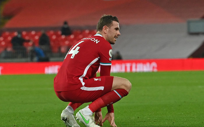 Liverpool midfielder Jordan Henderson reacts after picking up an injury during the English Premier League football match between Liverpool and Everton at Anfield in Liverpool, north west England on 20 February 2021. Picture: Paul Ellis/AFP