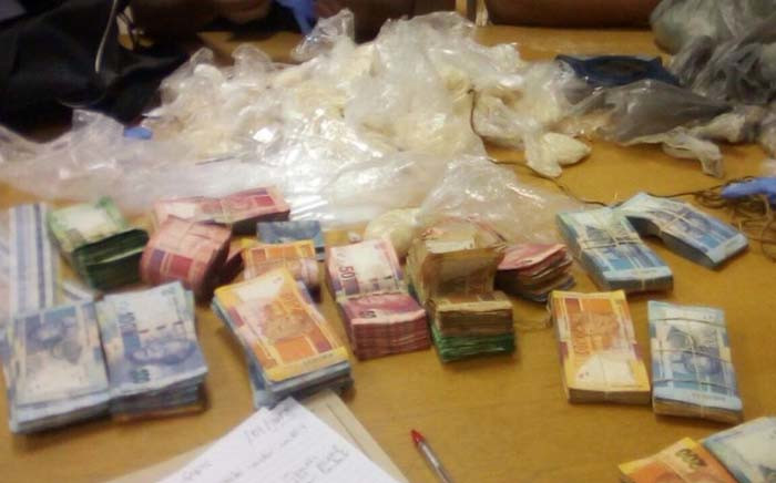 Drugs and money seized from two suspects during separate raids in Cape Town. Picture: SAPS.