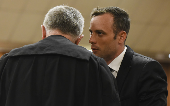 Advocate Barry Roux talks to his client, Oscar Pistorius, during a bail application in the High Court in Pretoria on 8 December 2015. Picture: Pool.