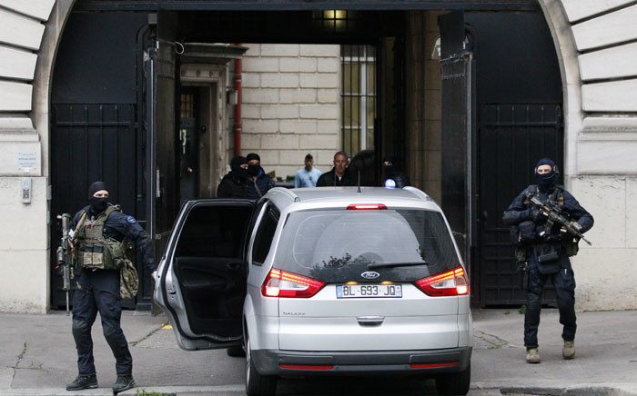 French police and members of the National Gendarmerie Intervention Group (GIGN) escort a convoy transporting a surviving member of the group that carried out Paris terror attacks suspect Salah Abdeslam to Paris courthouse for his first questioning by anti-terror judges in Paris on 20 May 2016. Picture: Matthieu Alexandre/AFP.