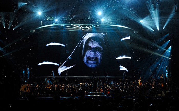 Actor Ian McDiarmid's Emperor Palpatine character from the Star Wars series of films is shown on screen while musicians perform during 'Star Wars: In Concert' at the Orleans Arena 29 May 2010 in Las Vegas, Nevada. Picture: AFP