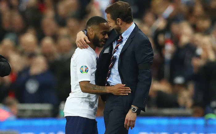 FILE: England soccer team manager DescriptionGareth Southgate congratulates attacking midfielder Raheem Sterling after a match against the Czech Republic on March 22, 2019. Picture: @England/Twitter.