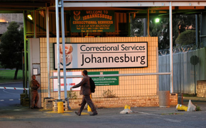 A correctional services official arrives for work at the Johannesburg Central Prison on Monday, 22 October 2012. Picture: Werner Beukes/SAPA