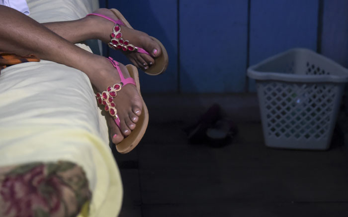 FILE: A sex worker rests at a bar in Calamar municipality, Guaviare department, on 11 October 2018. Picture: AFP