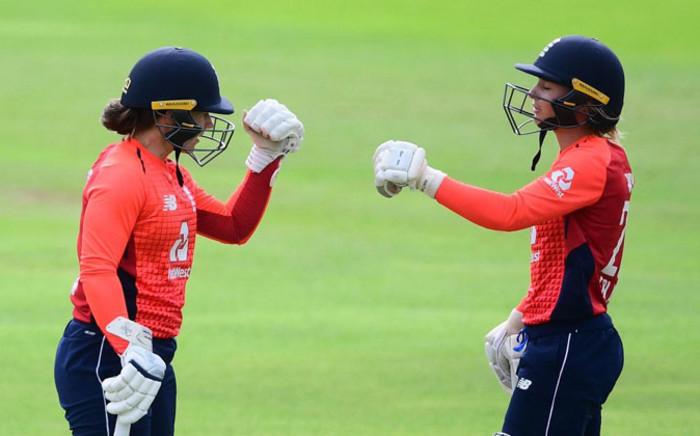 England batsman Tammy Beaumont (left) celebrates her century. Picture: @OfficialCSA/Twitter