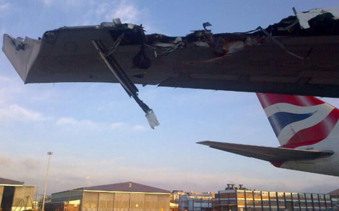 The right wing of the Boeing 747 crashed into a support services building while the aircraft was taxiing down the wrong taxiway on 22 December. Picture: IWITNESS.