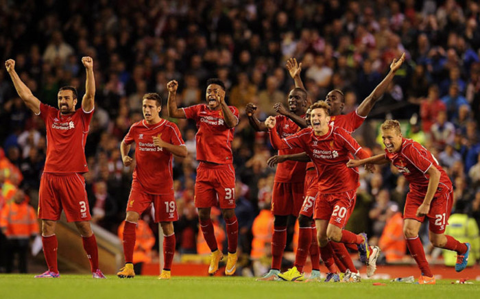 Liverpool players jump for joy after beating Middlesbrough 14-13 in the longest-ever penalty shootout in the League Cup on 23 September 2014. Picture: Official Liverpool Facebook page.
