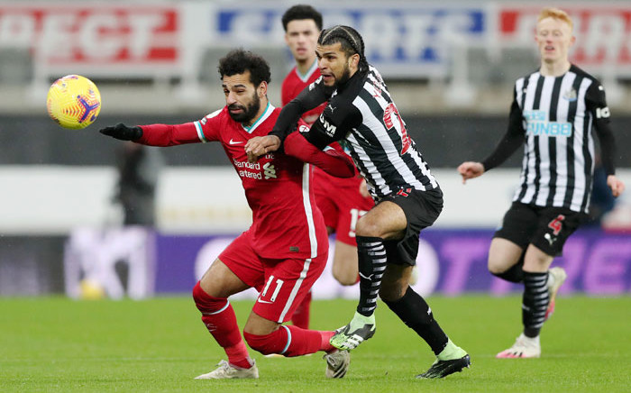 Liverpool's Mohammed Salah attempts to hold off a Newcastle defender during their English Premier League match on 30 December 2020. Picture: @LFC/Twitter