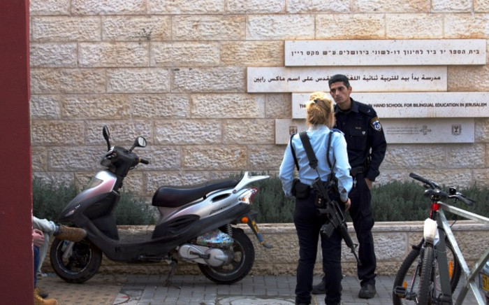 Israeli police officers stand outside the Hebrew Arabic 'Hand in Hand' school in Jerusalem on 1 December 2014. Picture: EPA.