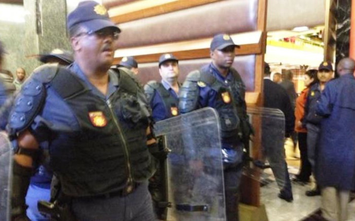 Police with riot shields arrive at the National Assembly on 21 August 2014. Picture: Gaye Davis/EWN.