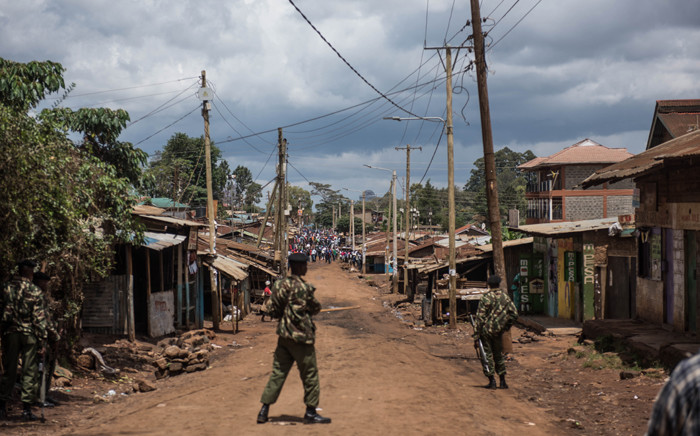 Kenyan police officers stand guard as demonstrators head for the Gatina polling station in the Kawangware district in Nairobi, on 26 October 2017. Picture: AFP