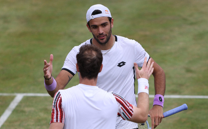 Italy's Matteo Berrettini (top) greets Britain's Andy Murray during their men's singles second round tennis match at the ATP Championships tournament at Queen's Club in west London on June 17, 2021. Italy's Matteo Berrettini beat Britain's Andy Murray 6-3, 6-3. Picture: Adrian DENNIS / AFP
