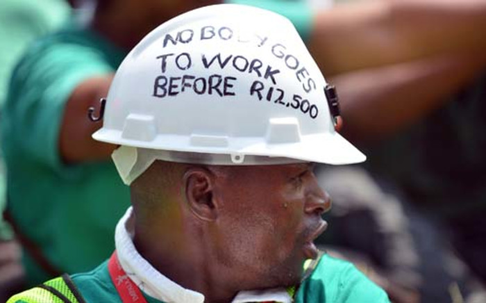 Amcu members have been on strike for higher wages since January. Picture: AFP.
