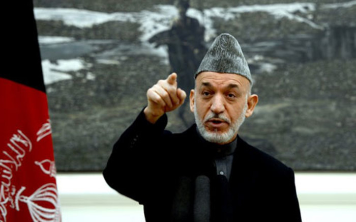 Afghan President Hamid Karzai addresses a press conference at the presidential palace in Kabul on December 8, 2012. Picture: AFP/ Massoud HOSSAINI