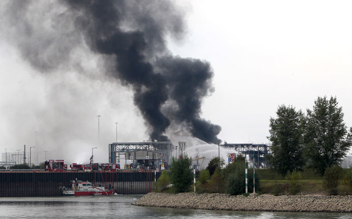A long column of smoke rises from the Chemical plant of the BASF site in Ludwigshafen, western Germany on October 17, 2016. Several people were missing and others were injured after an explosion at a chemical plant at BASF's headquarters in western Germany, the firm said, advising local people to stay indoors. Picture: AFP